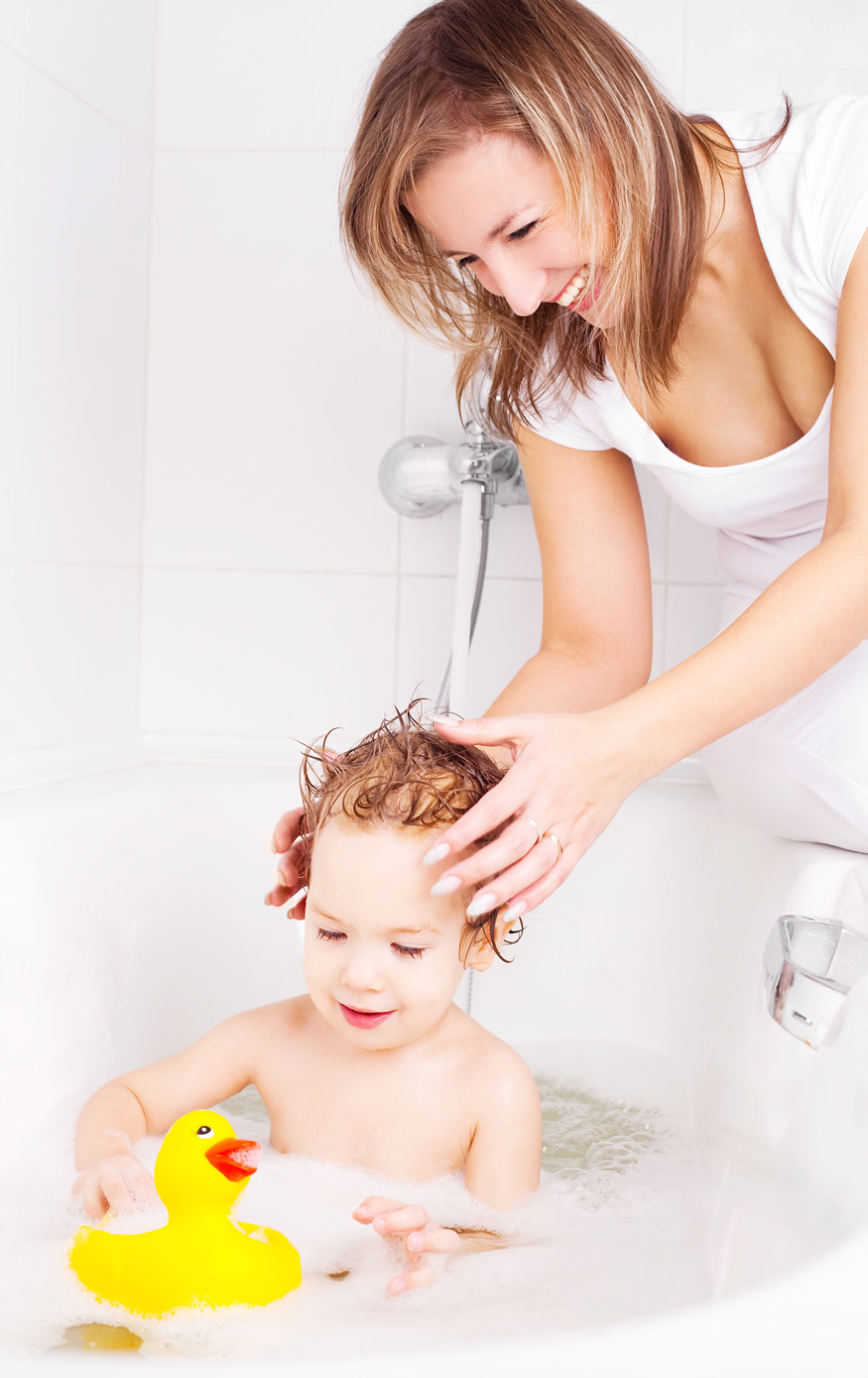 mother bathing her child with Eczema