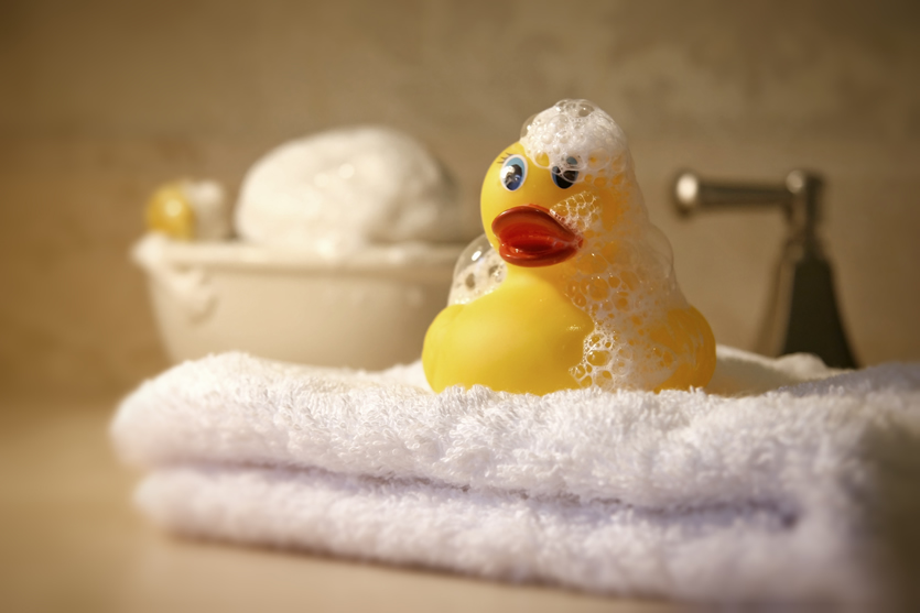 Rubber duck on towel with bubbles